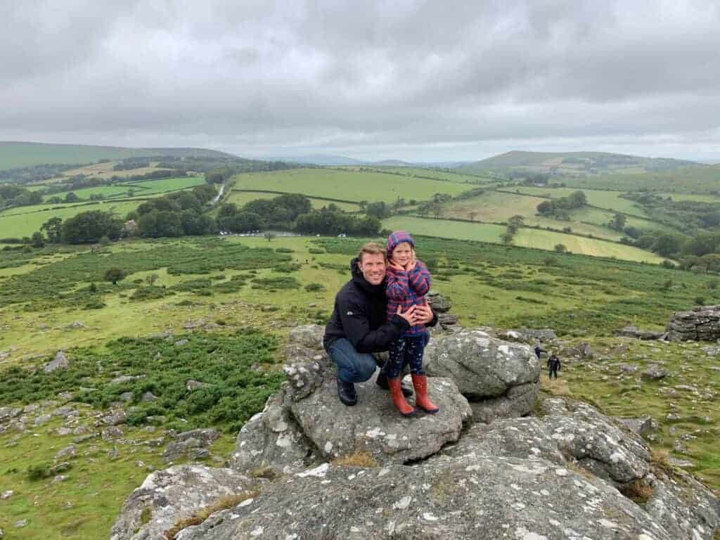 Father and daughter on top of Hound Tor in Dartmouth