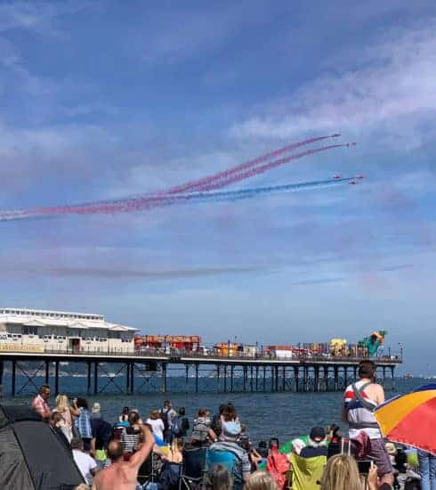 Red arrows flying past Paignton Beach during The English Riviera Airshow in Devon