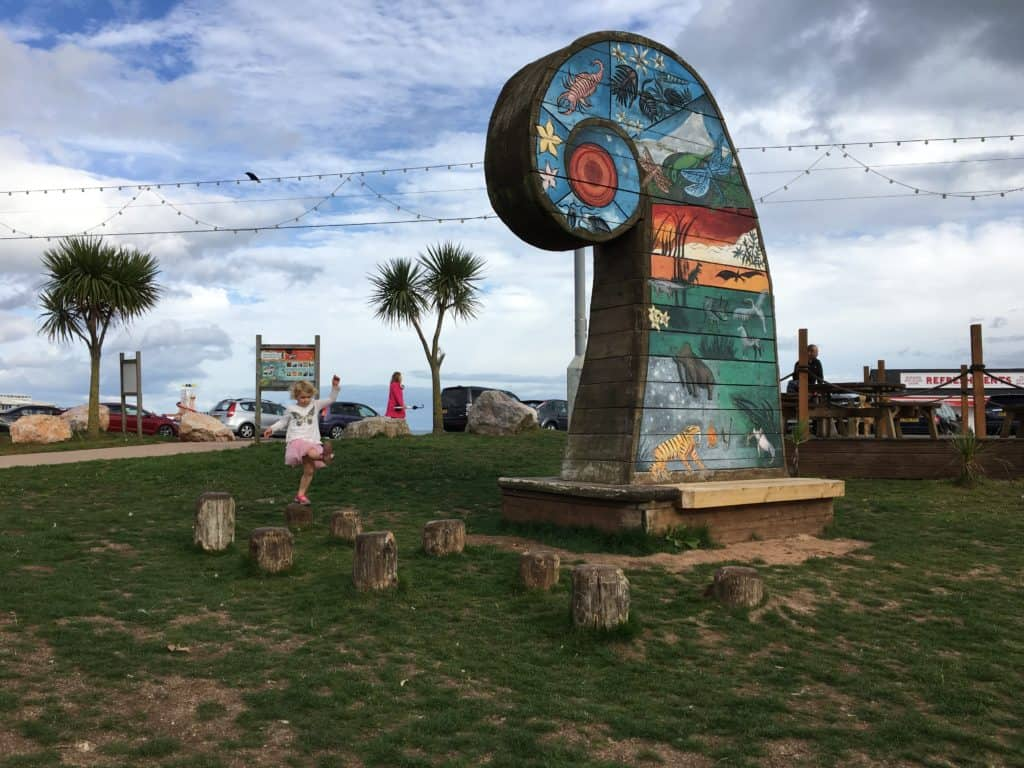 Colourful feature showing periods of time at Geoplay Park in Paignton, Devon