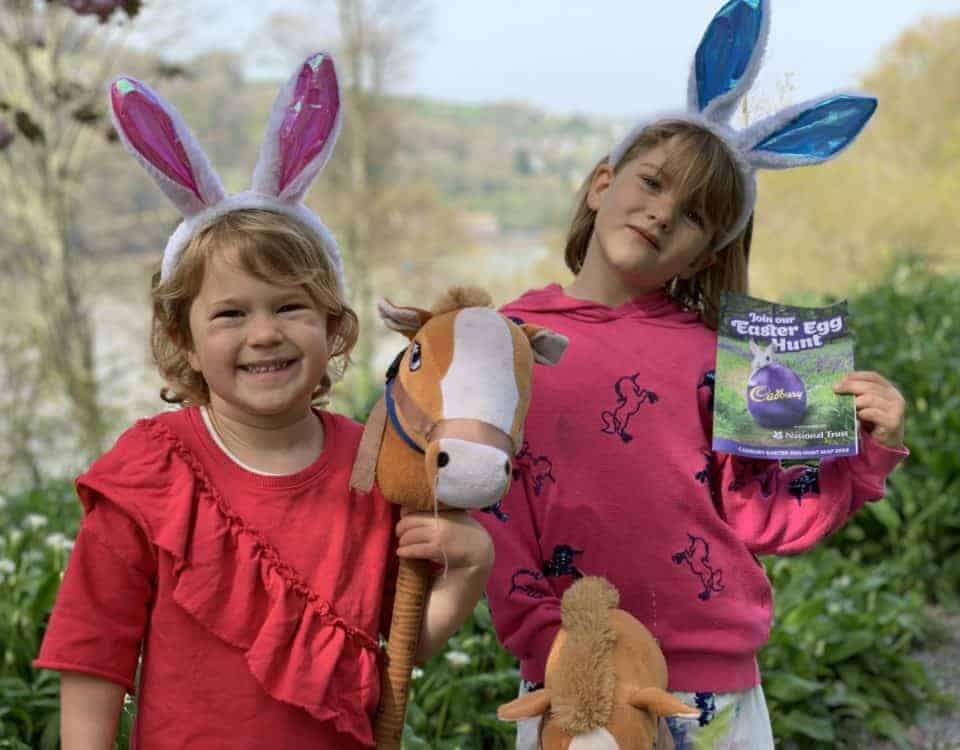 Kids wearing bunny ears on Easter egg hunt in Devon