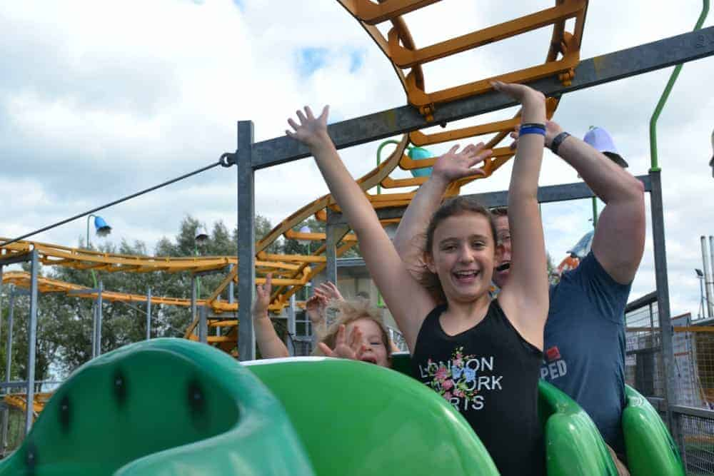 Kids on the Cosmic Caterpillar rollercoaster at The Milky Way theme park in North Devon