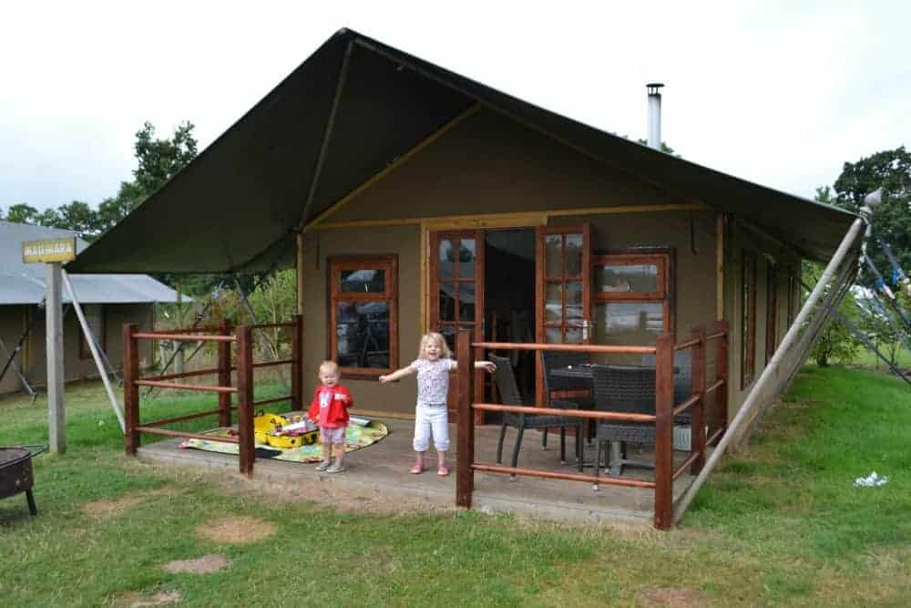 Children outside safari tent style glamping at Crealy Meadows in Devon, England