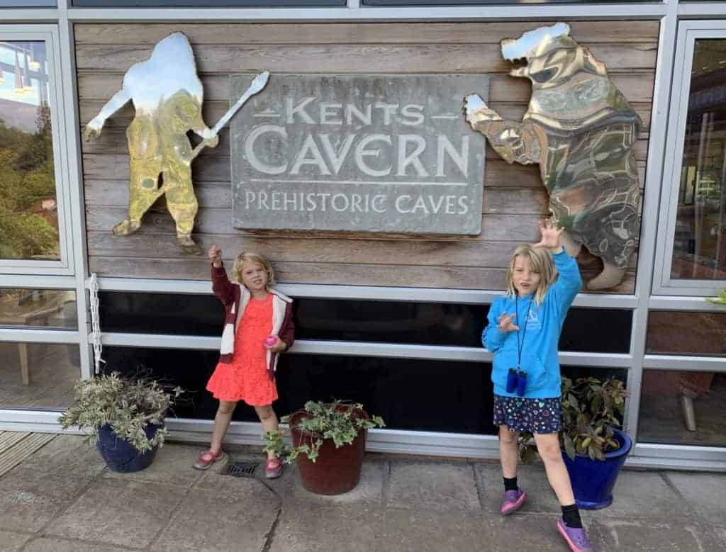 Children pretend to be cave bears outside Kents Cavern caves in Torquay