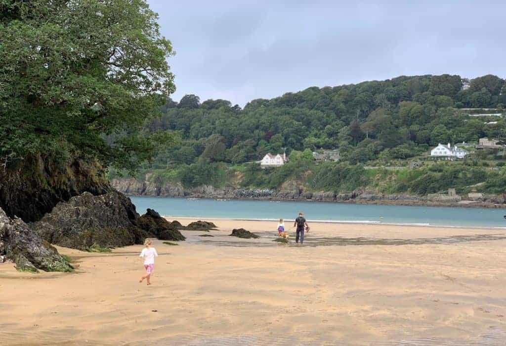Family on sandy beach at Mill Bay near Kingsbridge in South Devon