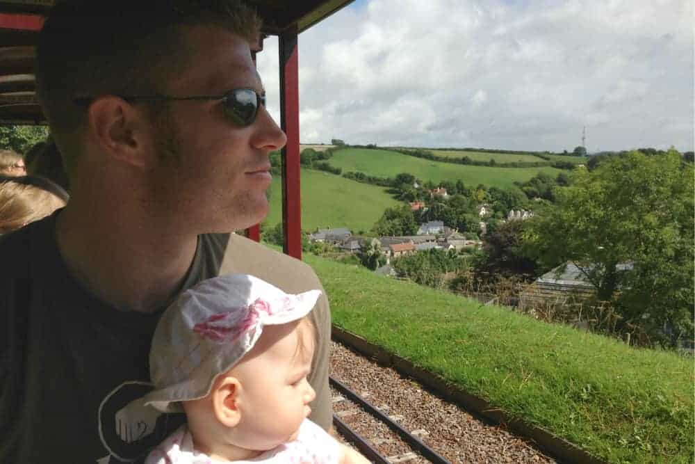 Father and baby on Pecorama Beer Heights Light Railway in Beer