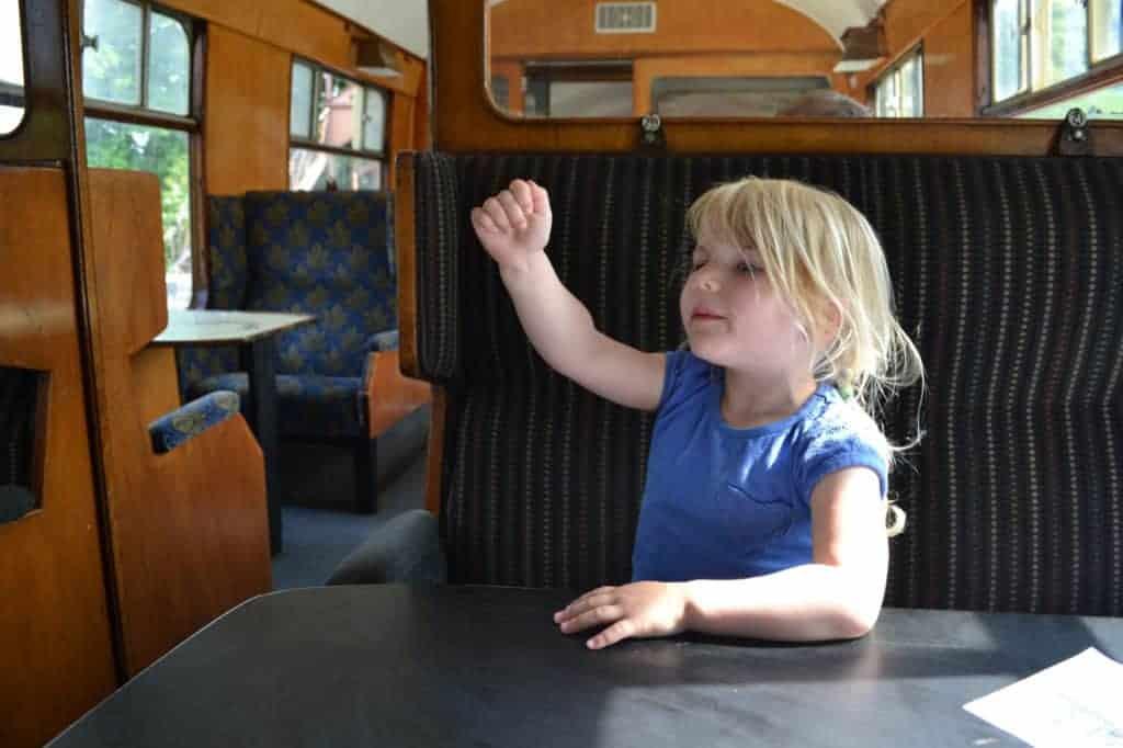 Child in vintage train carriage on South Devon Railway