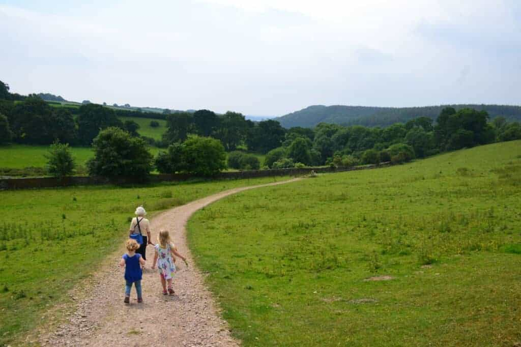 Family walking at trail at Buckland Abbey estate on Dartmoor