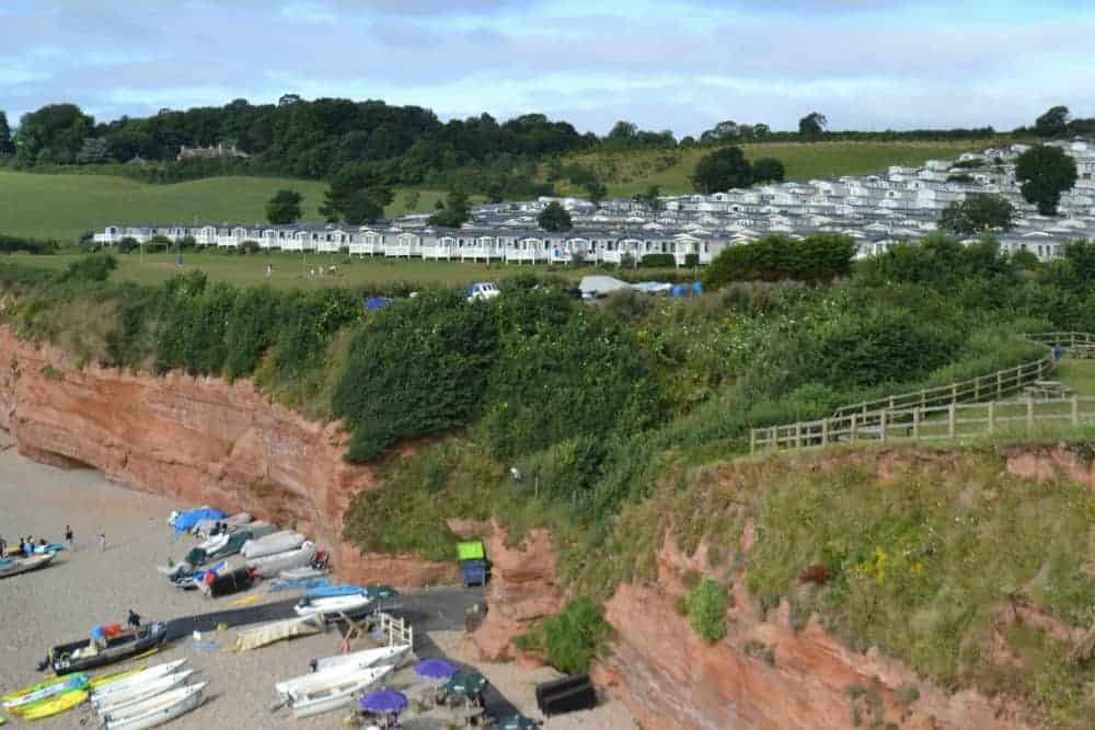 Holiday homes on cliff at Ladram Bay holiday park in Devon