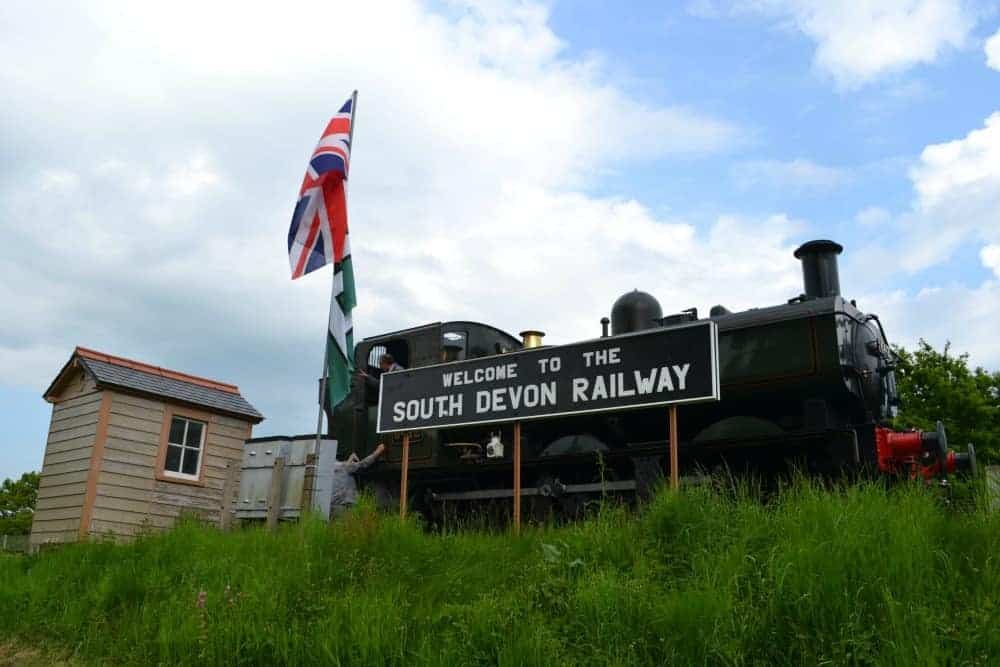 Welcome sign and stream train at South Devon Railway in Dartmoor, Devon