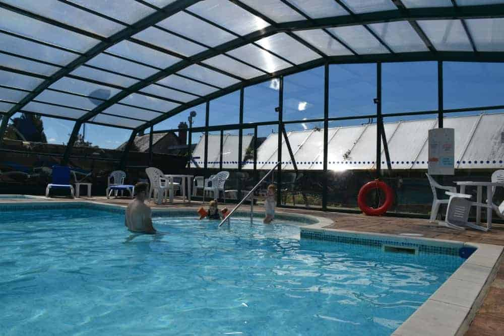 Covered swimming pool at Andrewshayes Holiday Park in Devon