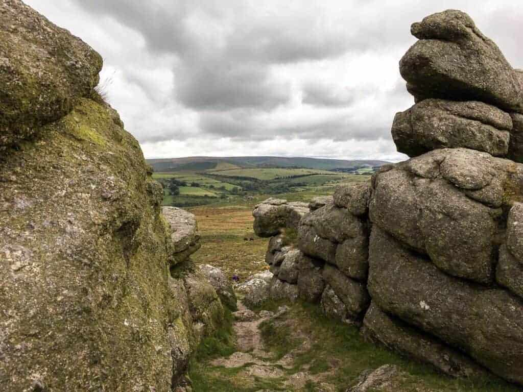 View from Haytor through granite stones - one of many places to go for walks on Dartmoor