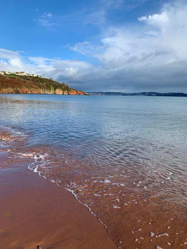 Red sand of beach in Paignton, Devon in winter