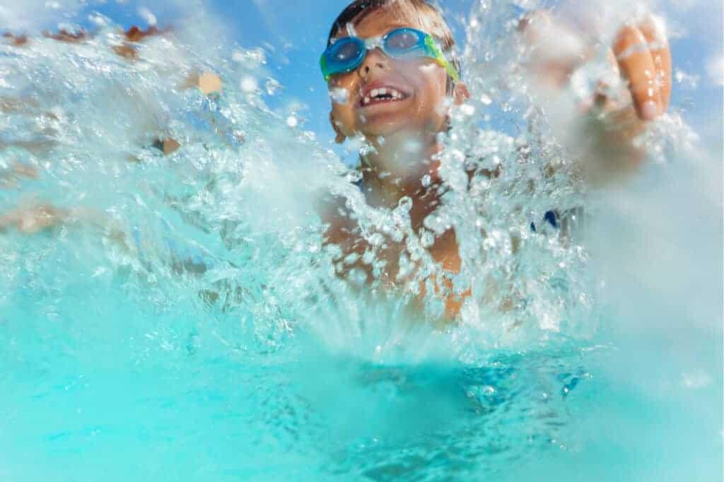 Boy splashing in water