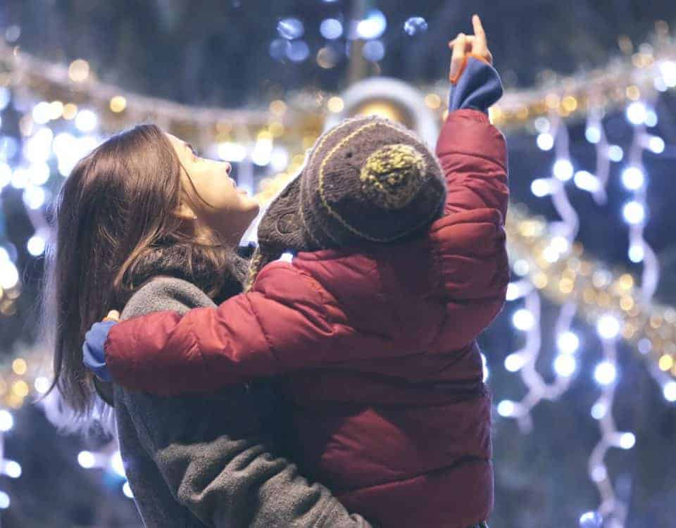 Woman and child looking at Christmas illuminations