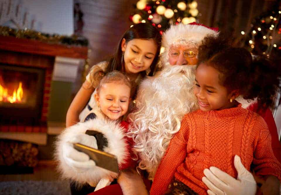 Father Christmas taking a selfie with children
