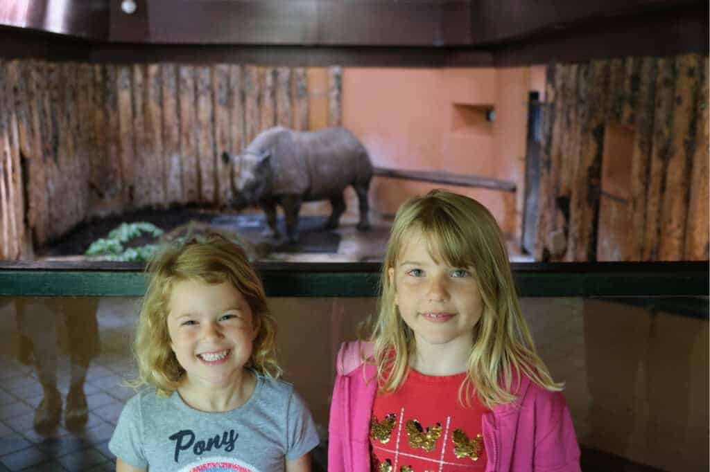 Children in front of black rhino