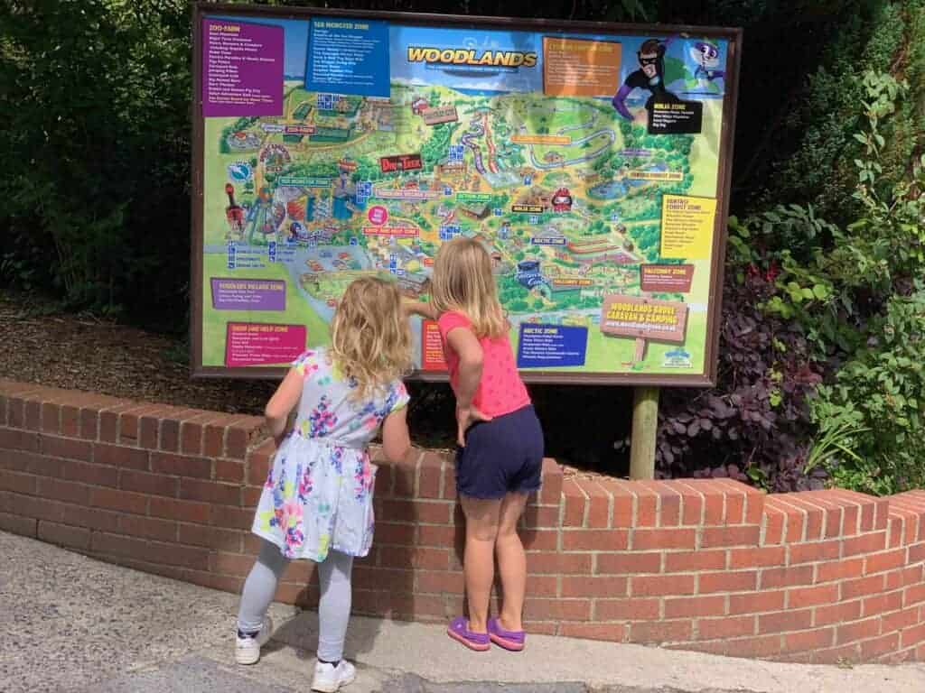 Children looking at Woodlands Family Theme Park site map
