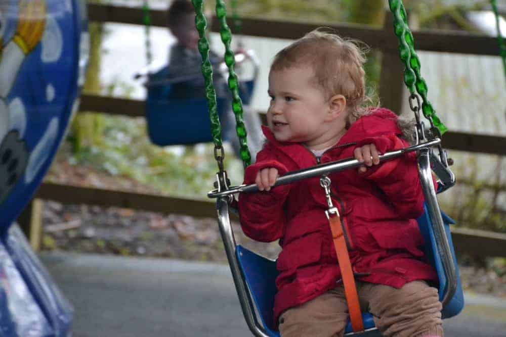 Child on merri-go-round