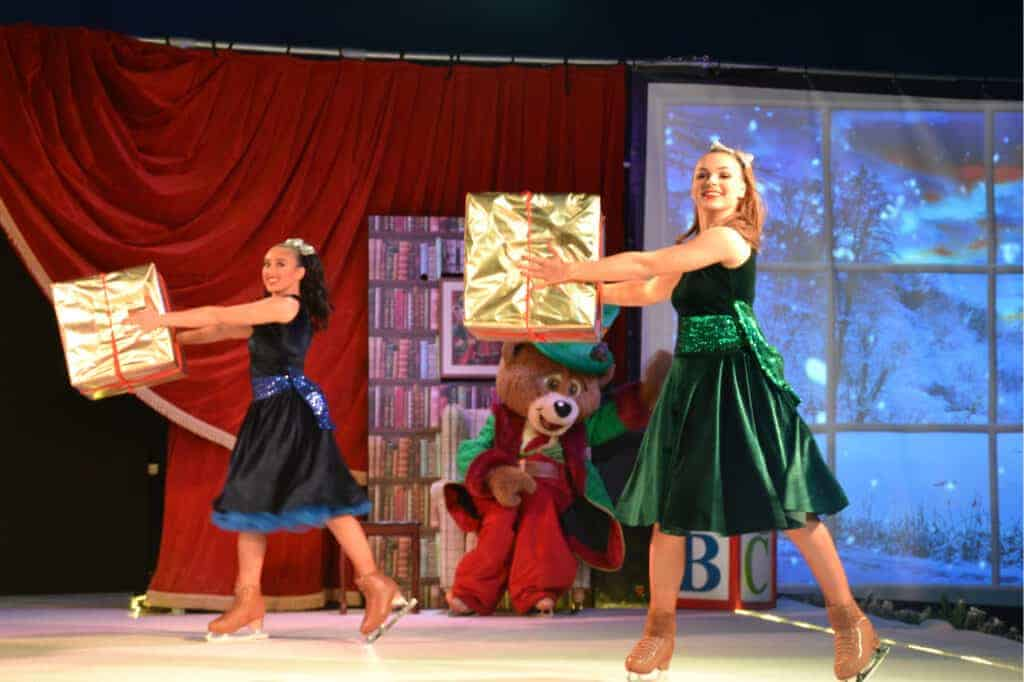 Ice skaters dancing with presents at Crealy Christmas Spectacular
