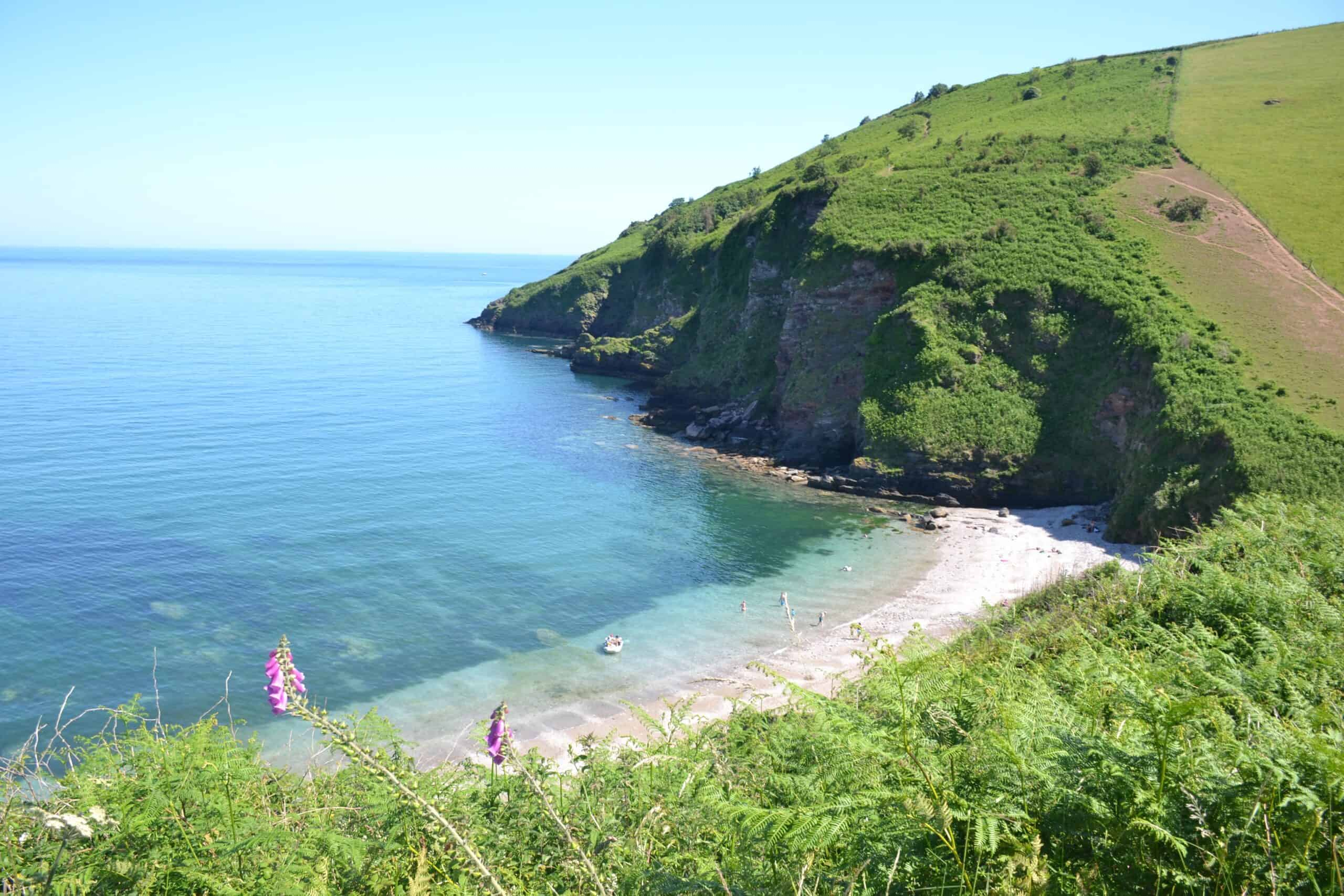 View of Scabbacombe Sands beach in Devon - a secluded bay