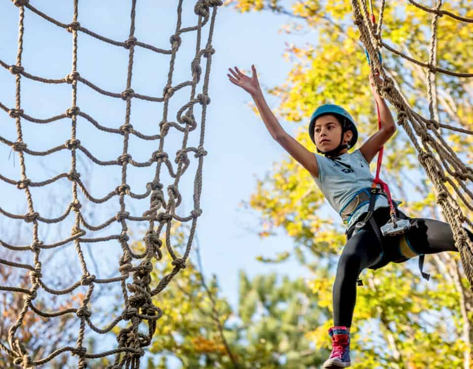Teen on high ropes course