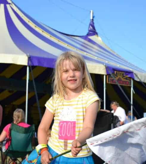 Child waving flag at festival in Devon