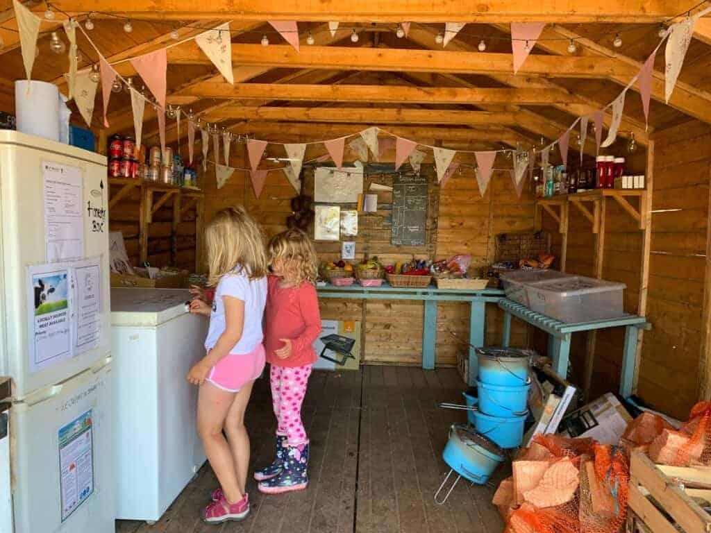 Children in honesty shop at Wilton Farm