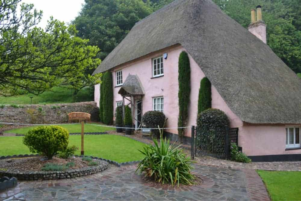 Pink thatched cottage in Cockington Village