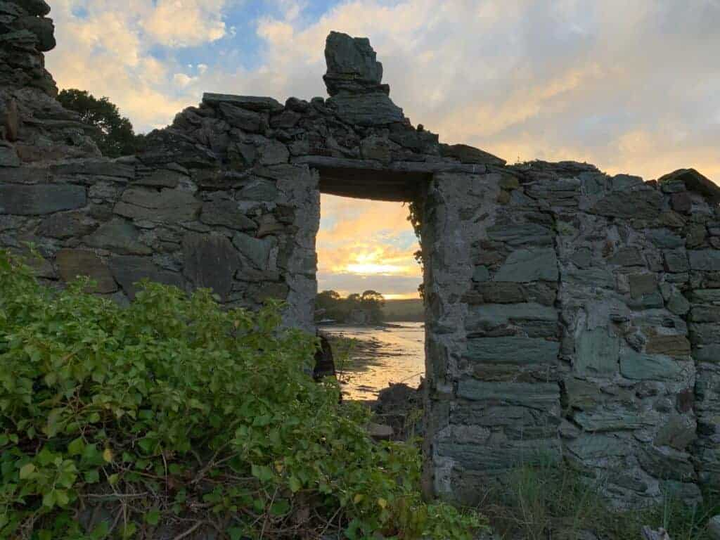 Sun set view through window of ruined building