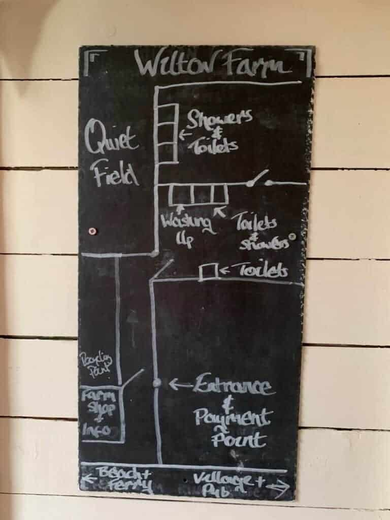 Black board showing layout of the campsite