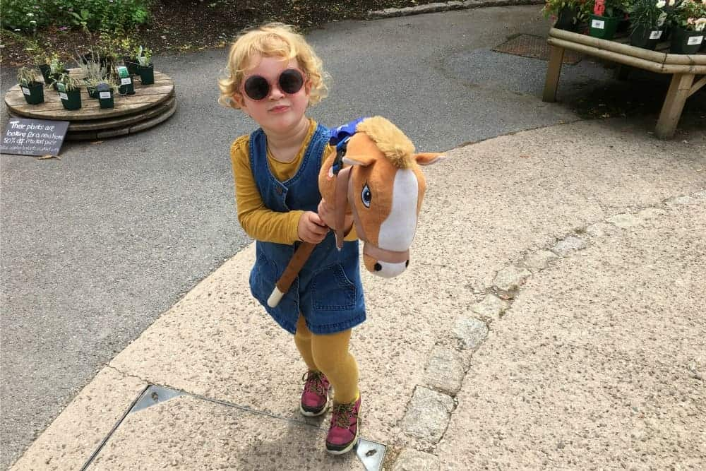 Child holding hobby horse at Greenway