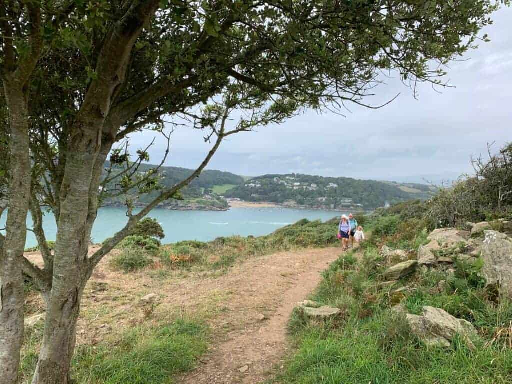 Family walking along South West Coast Path by Rickman Common