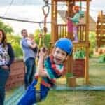 Boy on zip wire at adventure playground
