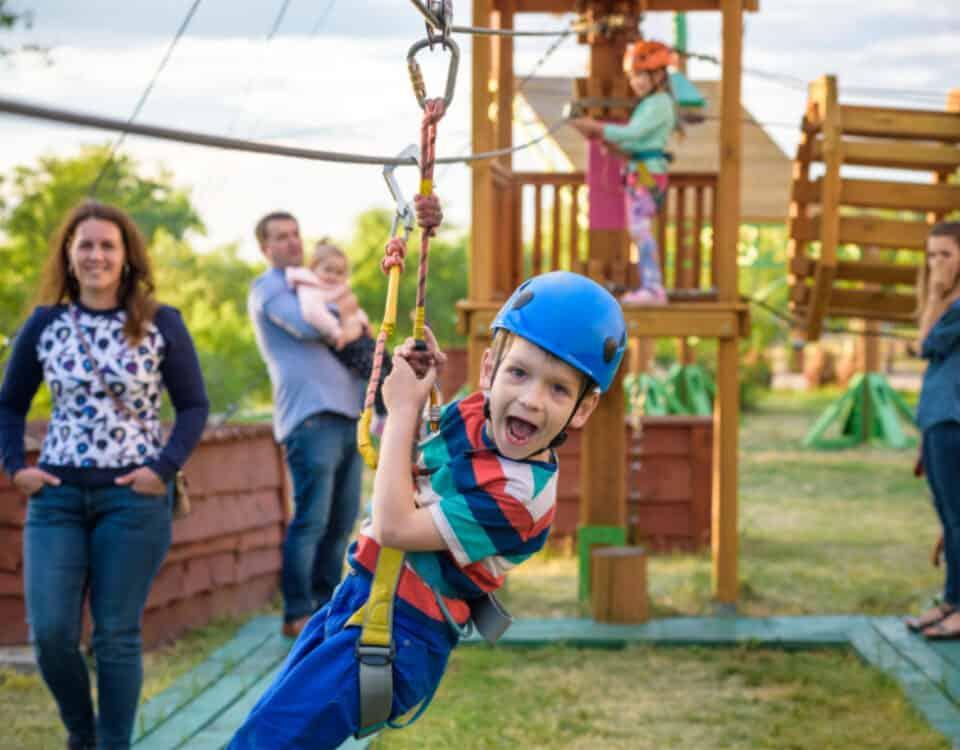 Boy on zip wire at adventure playground