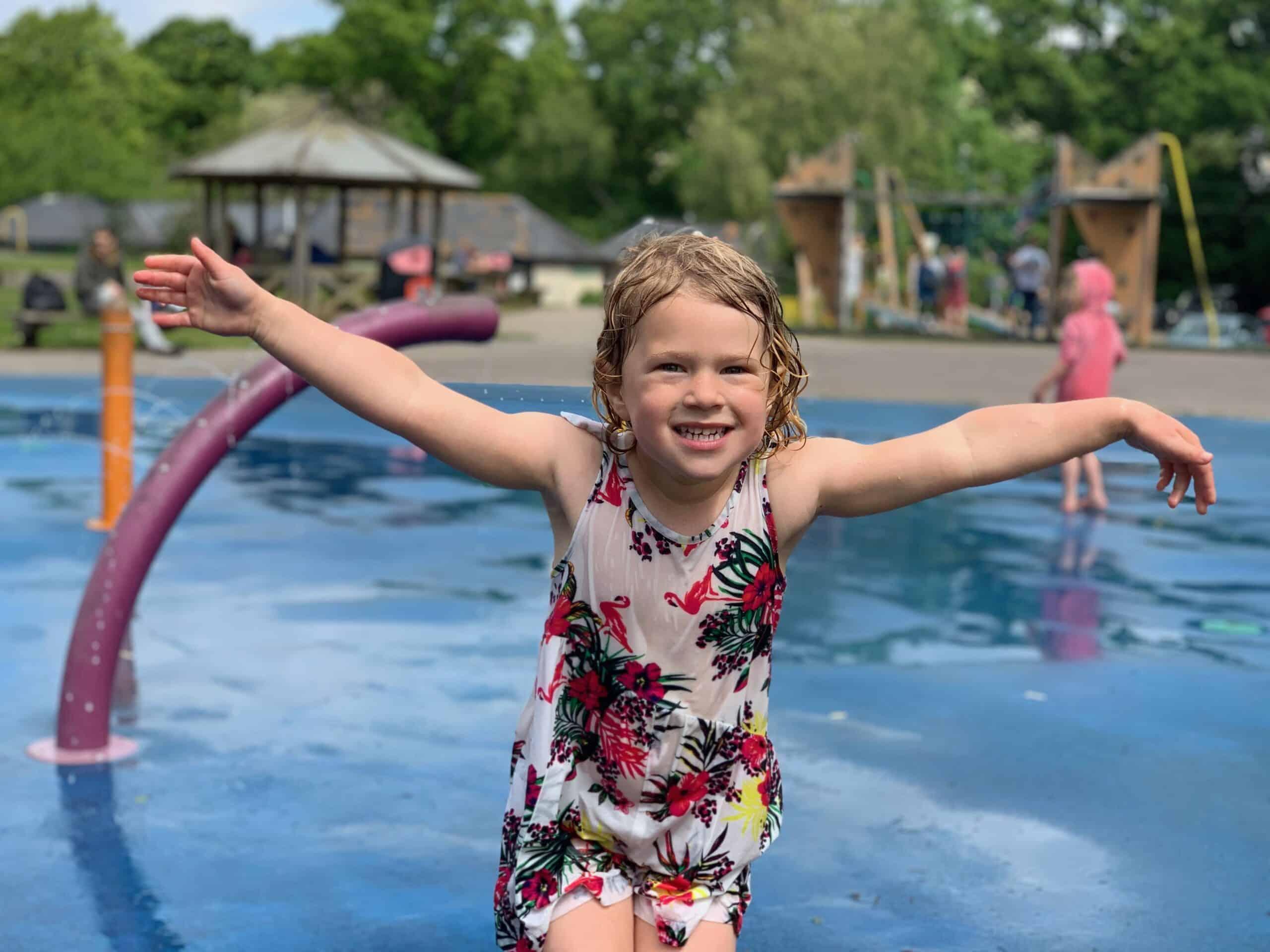 Child in splash park at Decoy Country Park adventure playground in Devon