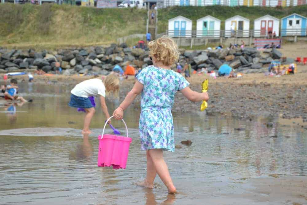 Child with bucket and spade on Summerleaze Beach in Bude