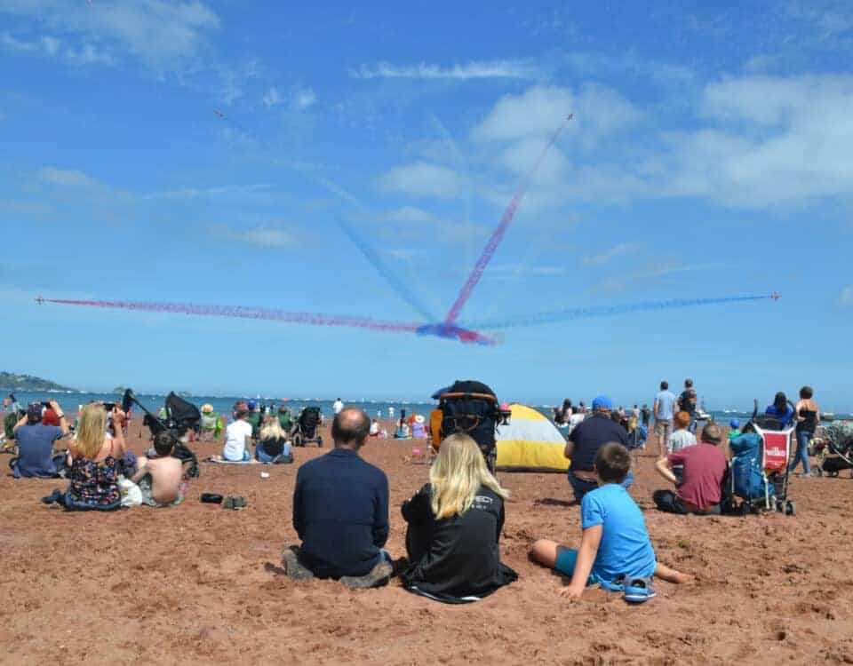 Red Arrows performing in front of Paignton Sands in the English Riviera Airshow