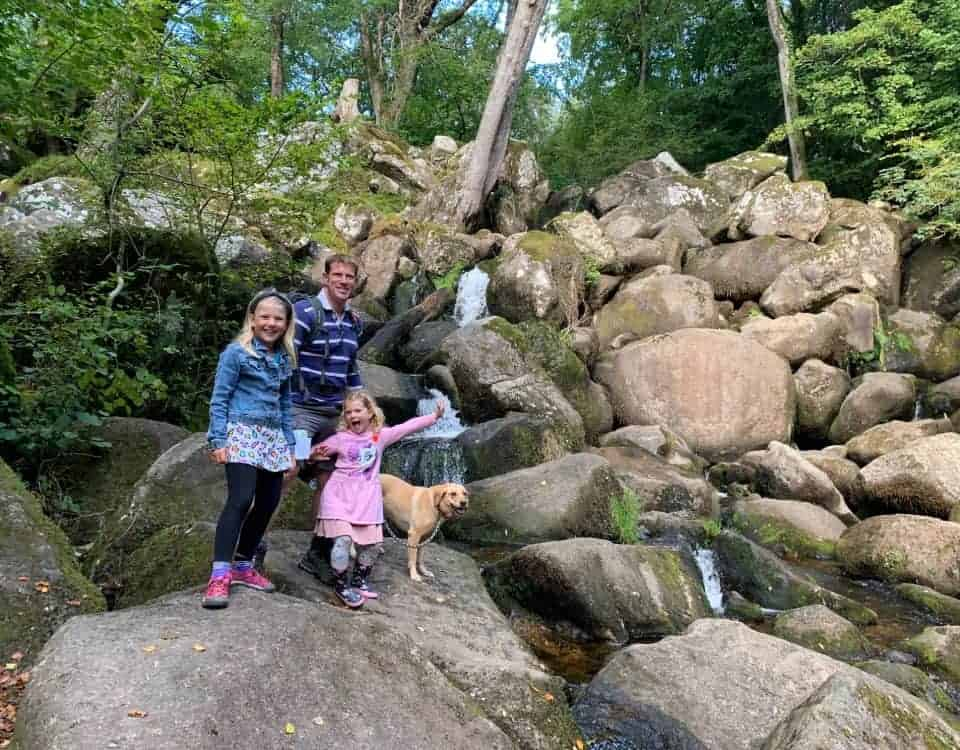 Family at Becky Falls waterfall in Dartmoor National Park