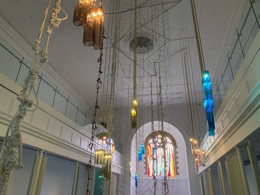 Hanging art installation and stained glass window in St Lukes Church