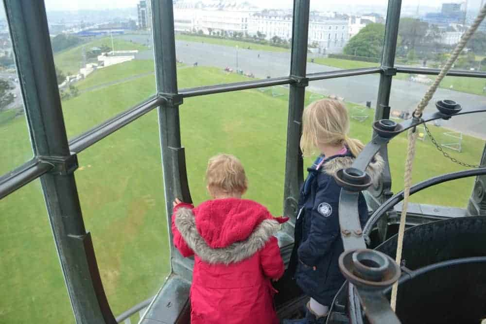 Children looking at the view from the top of Smeatons Tower on The Hoe in Plymouth