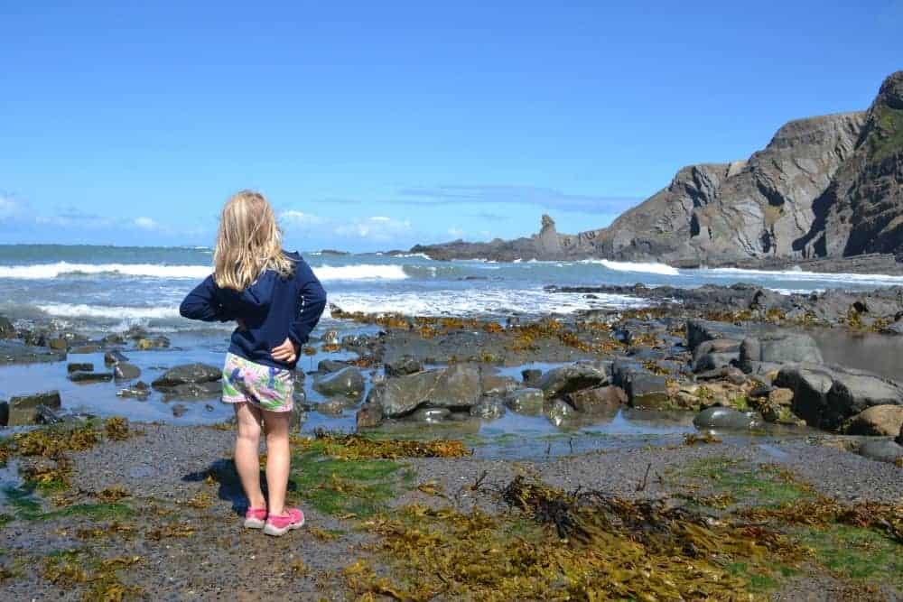 Girl stood at Hartland Quay beach