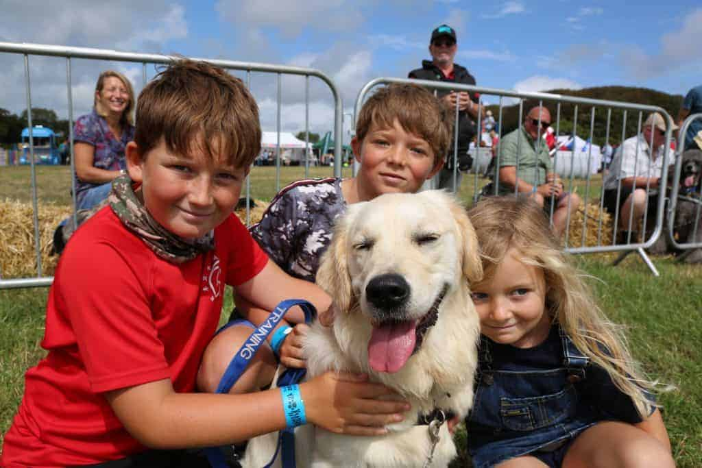 Kids and dog at Woofstock dog-friendly festival in Devon