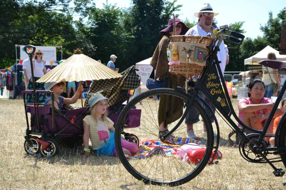 Children listening to story by the Story Cycle at Glas-Denbury festival in Devon