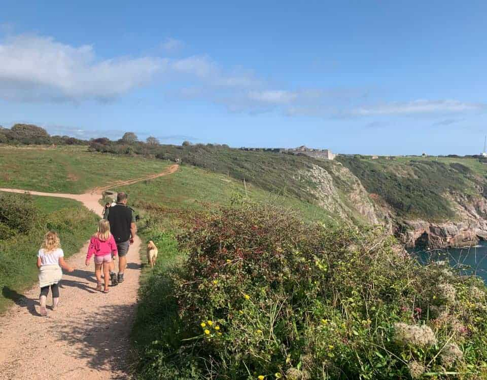 Family walking along footpath at Berry Head