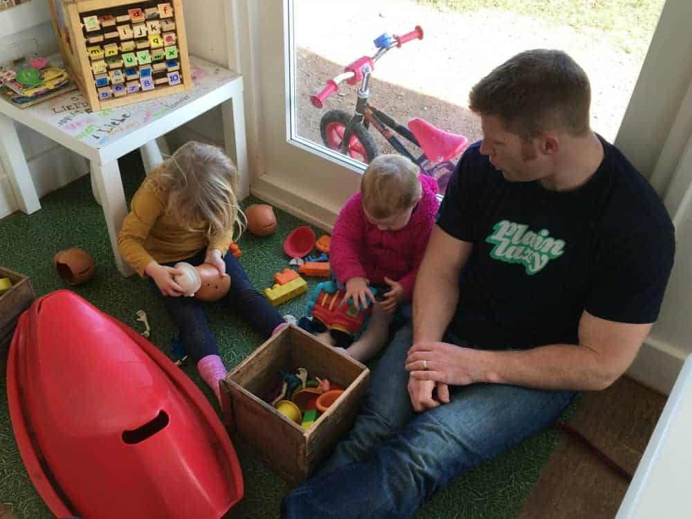 Children playing with toys and books in The Guardhouse Cafe