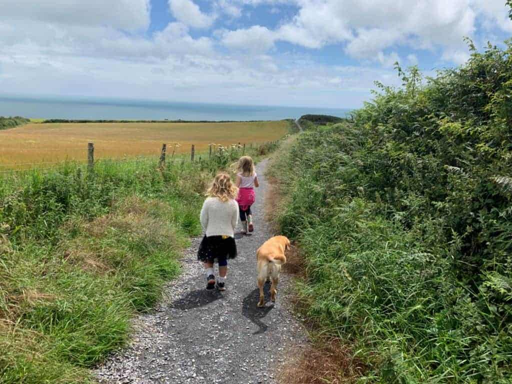 Children and dog walking down path out of Little Dartmouth car park