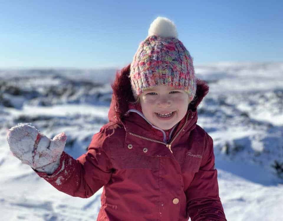 Child dressed for a snow day on Dartmoor