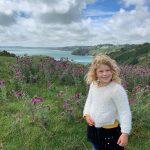 Child stood on Little Dartmouth footpath near Dartmouth in South Devon
