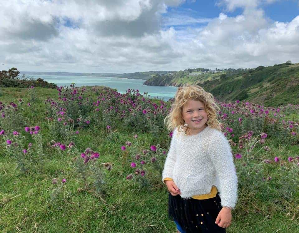 Child stood on Little Dartmouth footpath near Dartmouth in South Devon
