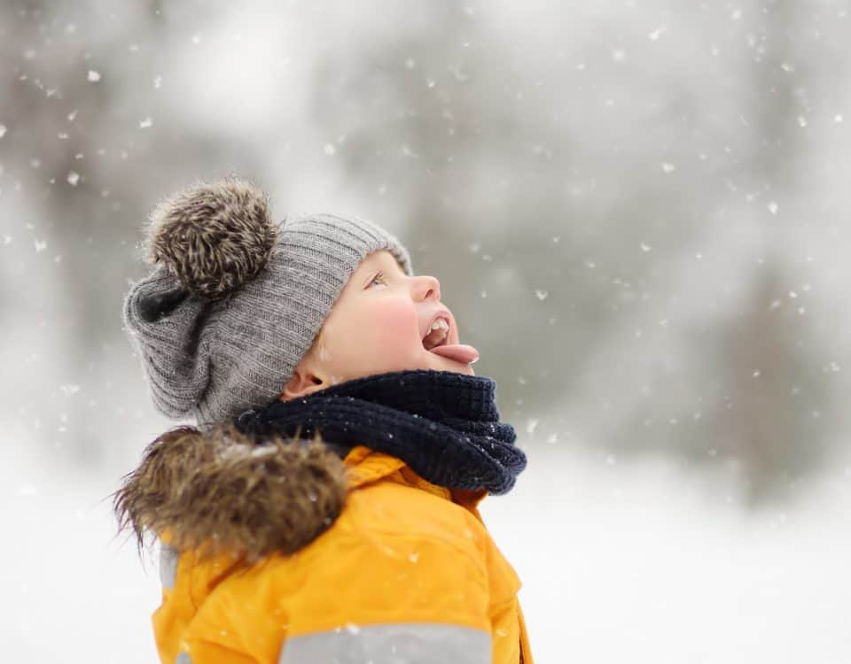 Boy catching snow on tongue